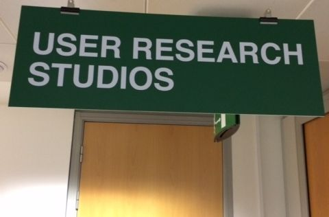 "Door with a sign that reads ""User Research Studios"""