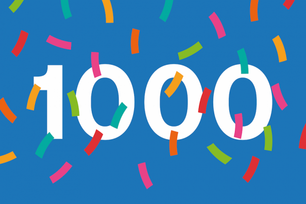 Number 1000 against blue background with celebratory confetti