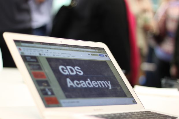 "Open laptop with ""GDS Academy"" written on the screen"