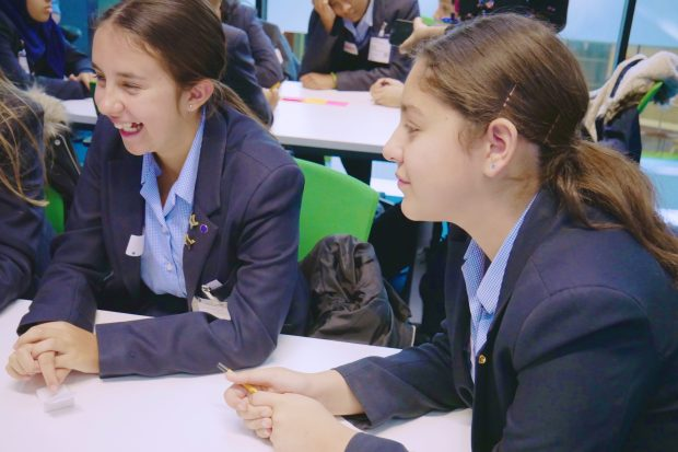 Two female students smiling at the Government Digital Service Career Insight Day