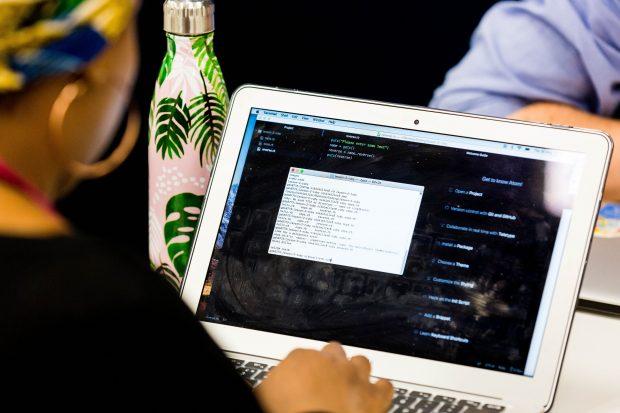Emerging Technology Development Programme's attendees study code on their laptop
