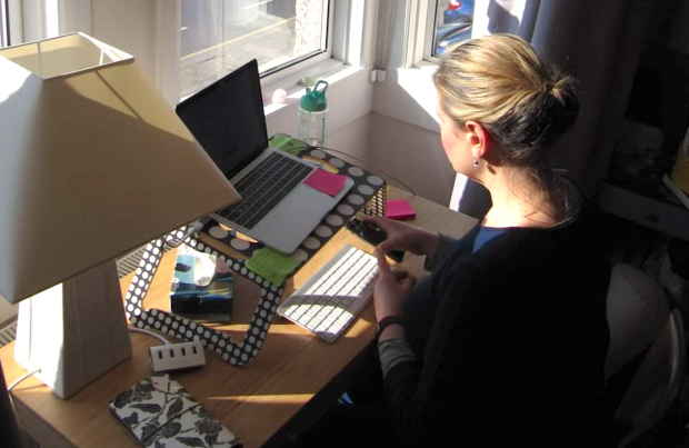 Picture of Liz working from her desk at home